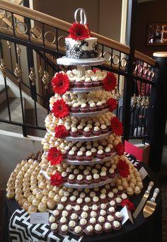 A beautiful summer wedding mini cupcake and gorgeous cake display at Madison's Brink Lounge.
