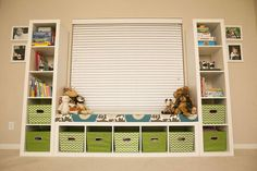 Kid Toy Storage - Using three Ikea Expedit shelves to frame a window in the playroom allows for optimal storage and easy access to the toys. P… kids storage Kid Toy Storage Ikea Regal Expedit, Ikea Expedit Shelf, Ikea Kallax, Ikea Shelves Bedroom, Ikea Kids Bedroom, Nursery Shelves, Toy Storage Shelves, Kid Toy Storage, Storage Ideas