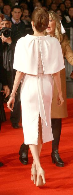 The back -Angelina Jolie in a cape dress at the Unbroken premiere