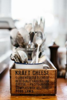 Utensil holder: How about a vintage Kraft Cheese wooden crate or box and a metal enamelware mug?