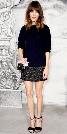 Alexa Chung - At haute couture fashion week, Chung arrived for the Chanel show in an all black ensemble including the label's quilted crossbody and tweed skirt.