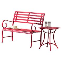 Bring a lovely touch to your patio seating group or accent your garden path with this red metal bench, showcasing a slatted design and scrolling arms.