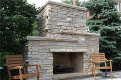 Large outdoor stacked stone fireplace! Nice.