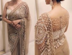 30 Latest Net Saree Blouse Designs Net sarees blouses are trending as they add this feminity, grace and elegance to your overall style. Here we've created the latest net saree blouse designs. These can be plain net saree with heavy … Net Saree Blouse, Latest Saree Blouse, Pattu Saree Blouse Designs, Chiffon Saree, Saree Dress, Drape Sarees, Work Sarees, Netted Blouse Designs, Fancy Blouse Designs