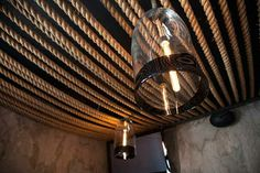 Jar lamps and rope ceiling