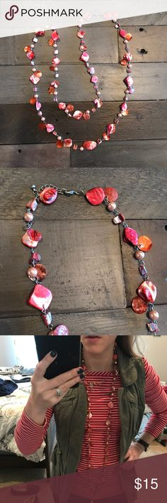 Red Shell and Chain Necklace Beautiful pink and red shell pieces plus beads spaces across a silver tone chain. Can be worn long or doubled Jewelry Necklaces