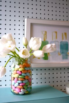 Spring Tulip arrangement hack using a water bottle and large mason jar.