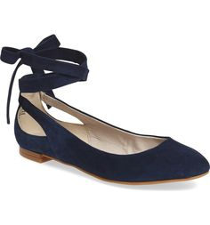 Graceful wraparound lacing tops this essential ballet flat detailed with demure cutouts at the heel.