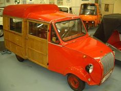 """1958 Biscuter Furgoneta. Introduced in February 1958, it was called Type 200-I (for """"Industrial""""), and was similar in style to the Citroen 2 CV utility truck body.  As opposed to the 200-C, the 200-I had a truck box of wood and steel, which extended out from the sides and was higher than the driver's roof. The Biscuter was also available as Type 200-I- P (for """"Practicable"""") with a canvas tarpaulin."""