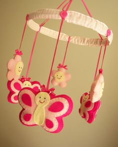 "Baby crib mobile, butterfly mobile, girl mobile ""Butterfly - Magenta"". $90.00, via Etsy."