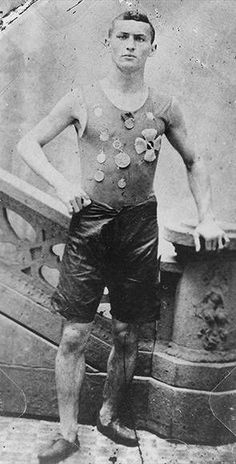 Ehrich Weiss (not yet Harry Houdini) wearing track team medals in 1890, New York (c)Library of Congress.