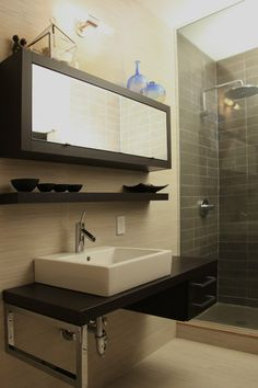 Cream/beige and charcoal bathroom with timber