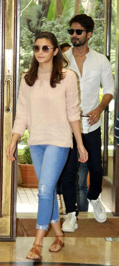 Bollywood actors Shahid Kapoor, right, and Alia Bhatt arrive for a news conference organized by the Indian Film and Television Directors Assn. in Mumbai on June 8, 2016.