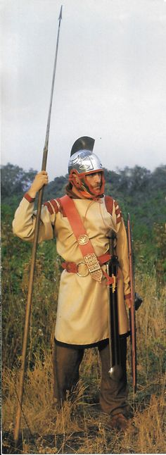 Reconstruction of a Junior Officer of Infantry, early 4th century CE, by the Milites Litoris Saxoni.-The Roman Legions Recreated in Colour Photographs. The tunic was modeled after one depicted in the Piazza Amerina mosaic in Sicily (minus the swastika-like applique on the skirt of the original)