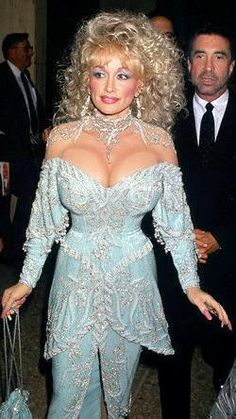 Surely one of the most jaw-dropping success stories in entertainment history, today's subject, Miss Dolly Parton, came from the simplest an. Dolly Parton Playboy, Dolly Parton Costume, Dolly Parton Tattoos, Beautiful Celebrities, Beautiful People, Dolly Parton Pictures, Musica Country, Female Movie Stars, Kylie