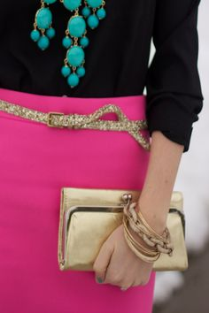 bold pops of color - turquoise statement necklace, fushia skirt balanced with black....and the belt is pretty cute too. ;)