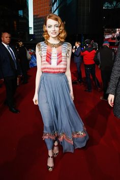 Emma Stone wearing Chanel Pre-Fall 2014 Gown, Christian Louboutin Just on Sandals and Chanel 1932 Plume Ring.