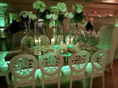 Under the table lighting from real customer Rachel! She creatively used several lights underneath glass tables to highlight the centerpieces and bring the focus back to the guests. Rent your uplights at diyuplighting.com for $19/each + free shipping! #diyuplighting