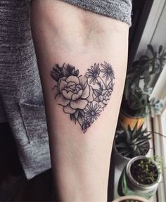 Heart shape with flowers tattoo