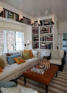 lovely book nook ~ lights on top shelf and by window great idea.