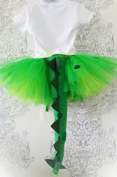 Back view of Dinosaur tutu skirt which comes with this fabulous detachable tail so it can be worn with other outfits.