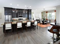 Black cabinets that extend to the ceiling make a dramatic design statement. The Pearl plan, a new townhome built by Label & Co. at Centra Falls. Pembroke Pines, FL.