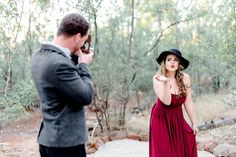 Blow us a kiss! Groom to be photographs his bride to be in these classic, 1940s inspired engagement pics!