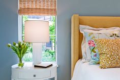 Now, this is a feminine bedroom that a man could feel comfortable in. The walls are light blue, the headboard is textured, but not frilly, and the bedding and furniture are a simple white. Can't live without florals? Then have fun with throw pillows, like the colorful floral styles seen here.  - GoodHousekeeping.com