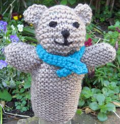 Free Knitting Pattern for Teddy Bear Hand Puppet - An easy pattern designed to be simple enough for children to knit. It's a garter stitch rectangle with some cast on and bind off for arms. Ears are shaped by sewing along head fold. Designed by Shelley Pearson for Knit a Square Charity.