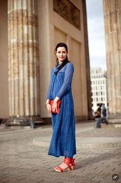 Anne-Christin Bansleben is a fashion designer. Her brand is called deepmello. She is wearing bag, shoes - deepmello and the dress is the wed...