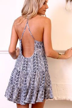 Navy and White Print Babydoll Dress with Open Back. $29.50