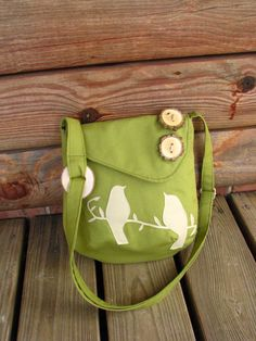 Mini Tweeting Birds Olive Green shoulder bag with adjustable strap.