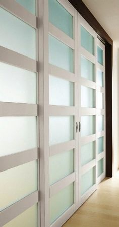 sliding doors from Modernus with recessed pull handles, use with glass to let in light, or try wood or lacquer inserts for a more defined division of space