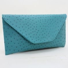 Large Ostrich Skin Print Envelope Blue Turquoise Clutch. Get the trendiest Clutch of the season! The Large Ostrich Skin Print Envelope Blue Turquoise Clutch is a top 10 member favorite on Tradesy. Save on yours before they are sold out!