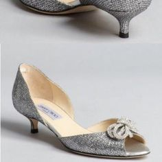 "Jimmy Choo Silver Glitter Crystal Bow Kitten Heel Authentic Jimmy Choo Silver Glitter Crystal Bow ""sapphire"" D'orsay Peep Toe Kitten Heel Pumps. Size 7.5 Worn once for my 1/2 of my wedding. Purchased from Sacks in 2013. Never worn again. Perfect condition. Just obviously wear on the bottom. It is a 2 inch heel. Made in Italy. Jimmy Choo Shoes Heels"