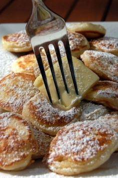 """Poffertjes"" - teeny pancakes cooked in dimple trays and served with icing sugar and butter."