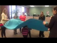 Family Yoga: Making Waves - YouTube Fun and creative use of a sheet to explore an ocean themed kids yoga class teaches deep breathing to find calm in the storm