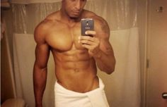 Jacked and ripped hunk does a bathroom selfie in a white towel