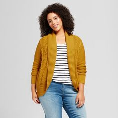 Wrap yourself in cozy, comfortable warmth with the Cable Cocoon Open Cardigan from Mossimo Supply Co.™ In mustard yellow, this shawl-collar cardigan features cable details along the front, bringing texture to your look. Pair with a cotton tee and boyfriend jeans for the ultimate comfy and casual look.