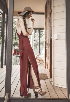 Shop this look for $135:  http://lookastic.com/women/looks/burgundy-maxi-dress-and-burgundy-crossbody-bag-and-chocolate-hat-and-chocolate-sandals/1309  — Burgundy Maxi Dress  — Burgundy Leather Crossbody Bag  — Chocolate Hat  — Chocolate Sandals