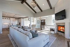 Massive great room a cozy fireplace with beautiful view to covered deck and grilling porch. Home Plan #161-1088. #homedecor #nice #life #lifestyle #luxurylifestyle #dreamhome