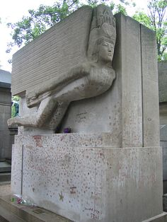 Tomb of Oscar Wilde and Robert Ross in Père Lachaise Cemetery, Paris. Designed by Jacob Ebstein in 1909, completed 1912. -- Wilde died of cerebral meningitis on 30 November 1900.He was initially buried in the Cimetière de Bagneux outside Paris; in 1909 his remains were disinterred to Père Lachaise Cemetery, inside the city.His tomb was designed by Sir Jacob Epstein,commissioned by Robert Ross, who asked for a small compartment to be made for his own ashes which were duly transferred in 1950.