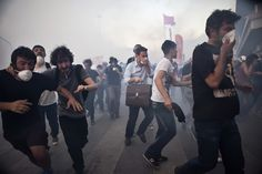 11 June 2013. Riot police attack early in the morning on the 15th day of Gezi Park resistance firing tear gas through barricades and using rubber bullets and water cannons against hundreds of protesters to clear Taksim Square early in the morning. Photo by Tolga Sezgin/Nar Photos.