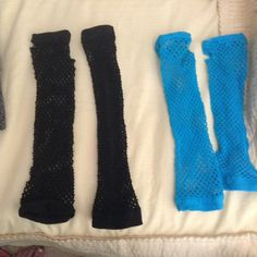 Two Pairs of Fishnet Gloves Two pairs of elbow length fingerless fishnet gloves, one in electric blue and one in black.  Very small, if any, tears of rips like the one in the last photo. Never worn Accessories Gloves & Mittens