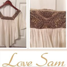 Boho LOVE SAM poncho w/ sequins blouse This blouse is a dreamy cream off white with tissue light crinkle gauze cotton material. It has beautiful detail of sequins around the collar. Sam Love blouses are the embodiment of chic bohemia. Round scoop neck poncho peasant type style blouse. Love Sam Tops Blouses