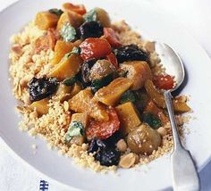 Vegetable tagine with almond & chickpea couscous recipe - Recipes - BBC Good Food
