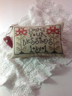 "Hand stitched cross stitched pin cushion cupboard tuck. With saying "" count your blessings"""