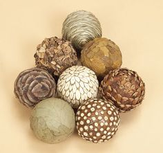 natural materials balls Glue pine cone pieces, bay leaves, and other natural components onto balls.