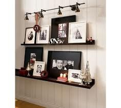 Picture Ledge- love the frames with black mats mixed with white frames