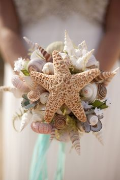 I don't plan on carrying a bouquet, but this is pretty :) .DIY Beach Wedding Inspiration Idea - Try your hand at creating this easy shell bouquet for your beach wedding! Little Mermaid Wedding, Seashell Bouquet, Beach Wedding Bouquets, Wedding Beach, Seashell Wedding, Bridal Bouquets, Gold Wedding, Boquet, Wedding Centerpieces